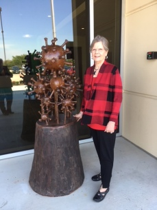 "Margo Green, Exhibit Chair for the Pearland Arts League with ""Virus"""